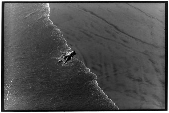 102_Kid lays on sand shore HB