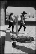 102_man sleeping on beach